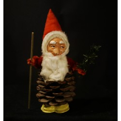 Tall, old pinecone elf with...